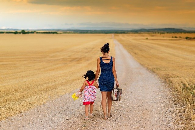 mother-child-walking-down-road